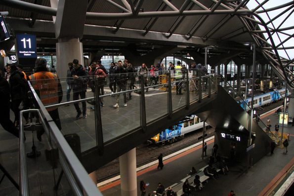 Metro staff direct passengers away from the failed escalator at Southern Cross platform 11
