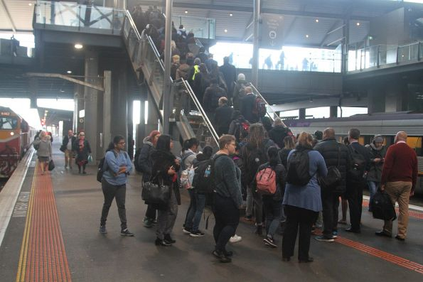 Long queue to exit Southern Cross platform 7 and 8 via the only route to Bourke Street - stairs