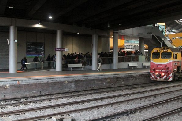 Long line of passengers trying to exit via the pair of ticket gates that lead to Southern Cross platform 1