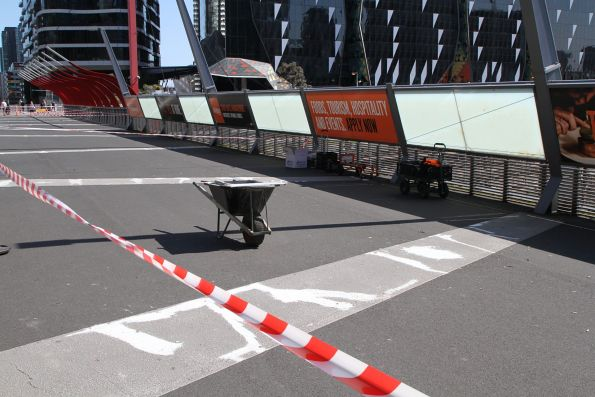 Painting over the cracks in the Bourke Street bridge at Southern Cross Station