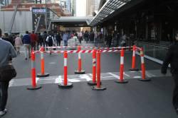 Filling in the cracks of the decorative concrete strips on the surface of the Bourke Street bridge