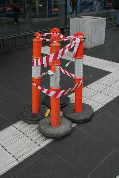 Broken tactile paving awaiting repair outside Southern Cross Station