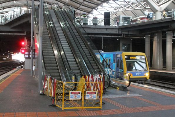 Two defective escalators at Southern Cross platform 9 and 10 have crippled the rail network