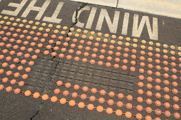 Cracked paving and loose tactiles at Southern Cross platform 3