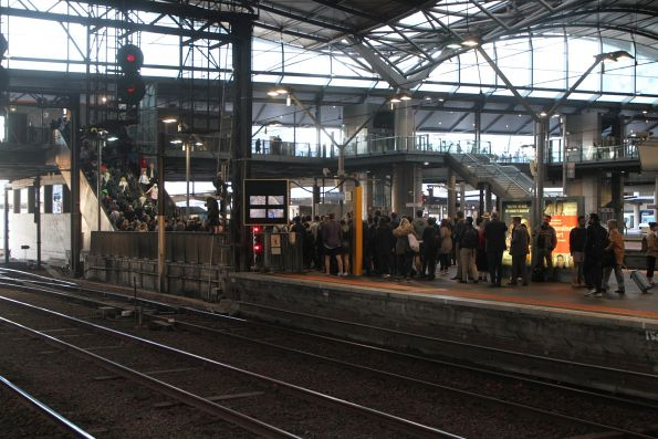 Massive crowd at the Bourke Street end of Southern Cross platform 9 and 10