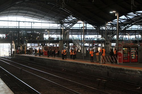 Metro staff on crowd control at Southern Cross platform 10