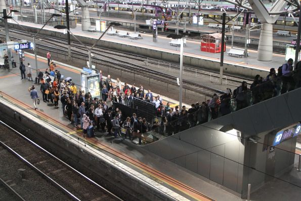 Queue to exit Southern Cross platform 9 and 10 due to a failed escalator