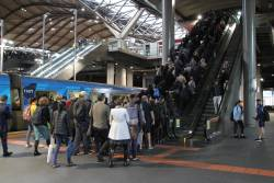 All three escalators working at Southern Cross platform 13 and 14, but there is still a queue to exit