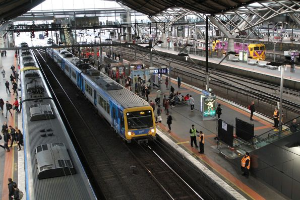 X'Trapolis train arrives into Southern Cross platform 10, one of the escalators still broken