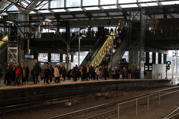 Congestion at the Bourke Street end of Southern Cross platform 9 due to a lack of escalator access at the other end