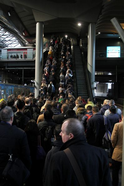 Queue for the escalators at Southern Cross platform 13 and 14