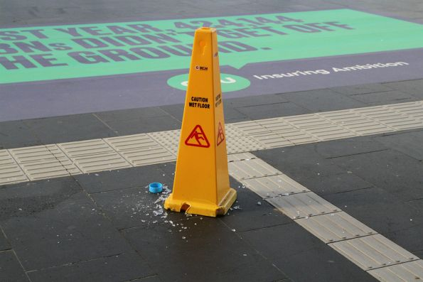 Broken glass all over the ground, and only a bollard to warn people