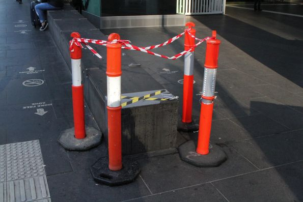 Damaged bluestone wall at the Spencer Street entrance to Southern Cross