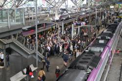 12 carriages worth of passengers try to exit via a single set of stairs at platform 5 and 6