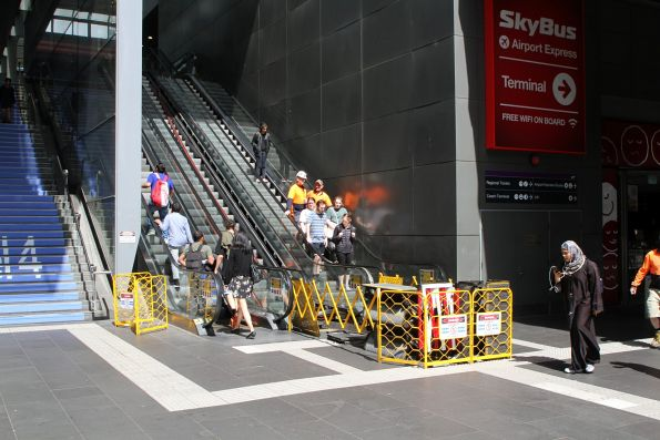 Repairing the escalator handrail between Spencer Street and the Bourke Street bridge