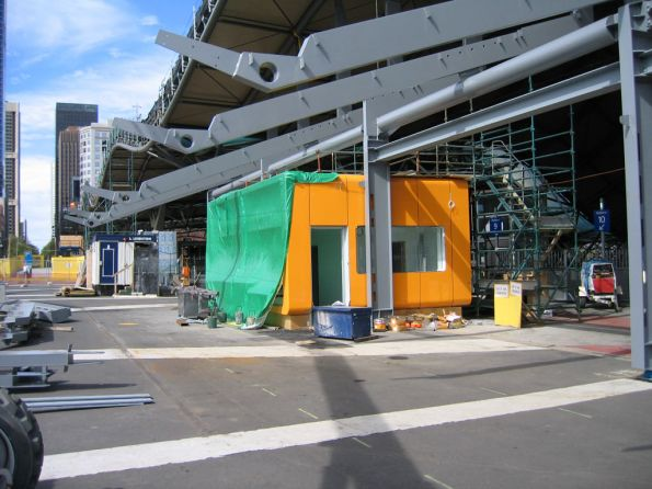 Awning and suburban ticket office on the Bourke Street bridge underway