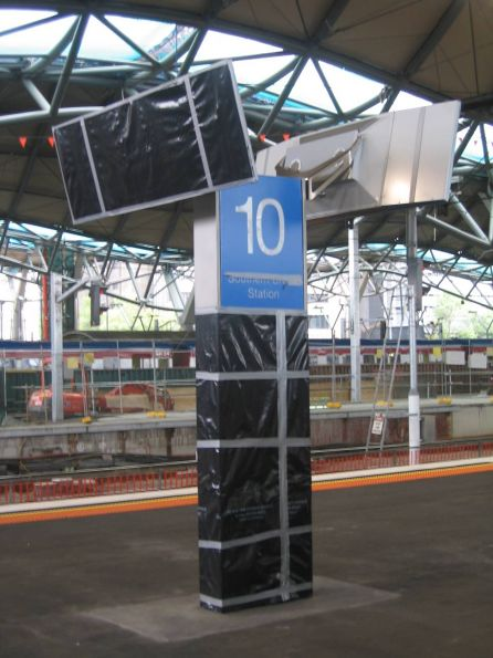 New 'Southern Cross Station' sign being installed on platform 9 and 10