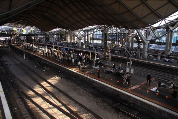 Suburban passengers waiting for their trains home