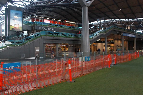 Artificial grass on the Collins Street concourse, permanent Great Glass Wall of Myki underway