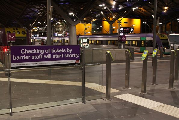 Sign informing passengers that ticket checking will soon start on the country platforms