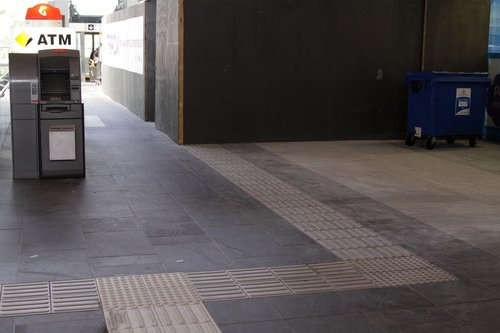 Now this is downright evil: tactile paving leading vision impaired people into the wall