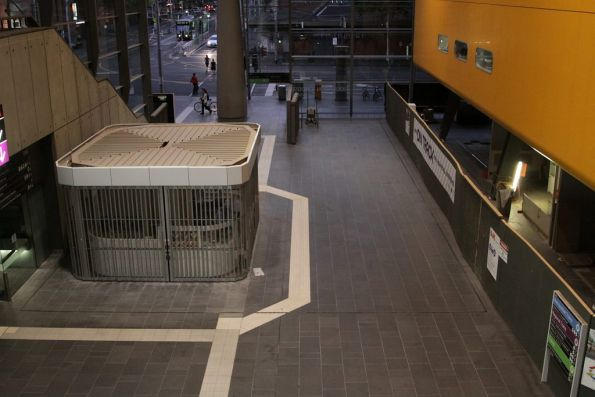 Tactile paving makes a deviation around a new shop at the Bourke Street entrance
