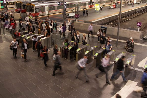 An entire trainload of Geelong passengers head for the bus terminal