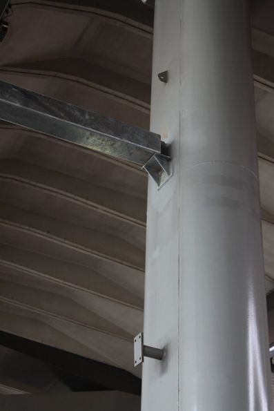 Overhead supports bolted directly to the piers supporting the overhead deck, instead of temporary structures