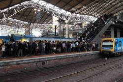 Up train departs an incredibly congested platform 10 at Southern Cross