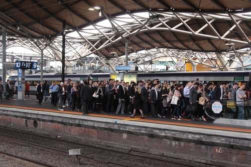 Slow moving queue of passengers for the escalators at Southern Cross platform 9 and 10