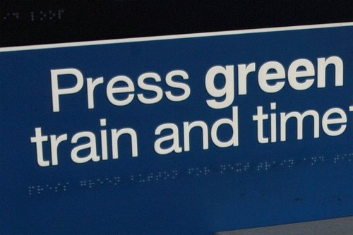 'Press green button' spelt out both in normal writing and in Braille