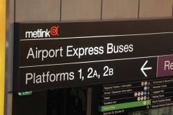 Massive 'Airport Express Buses' sign beneath the Bourke Street bridge