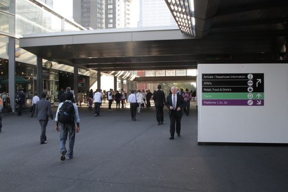 New signage in place to direct pedestrians around the new obstructions on the Bourke Street Bridge