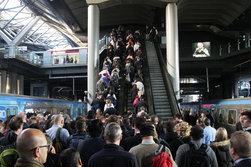 Congested escalators leading to the Collins Street concourse from platforms 13 and 14