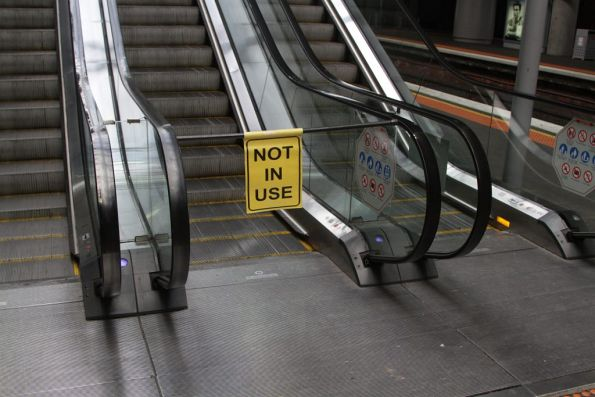 'NOT IN USE' flag across one of three escalators at Southern Cross Station