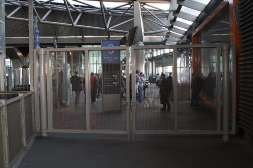 Steel gates block access between the V/Line paid area and the suburban paid area at the Bourke Street end