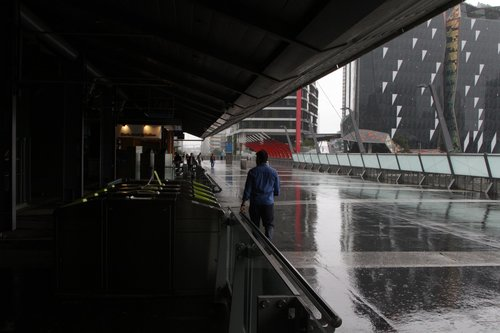 Pedestrians on the Bourke Street Bridge only have a narrow section of covered walkway