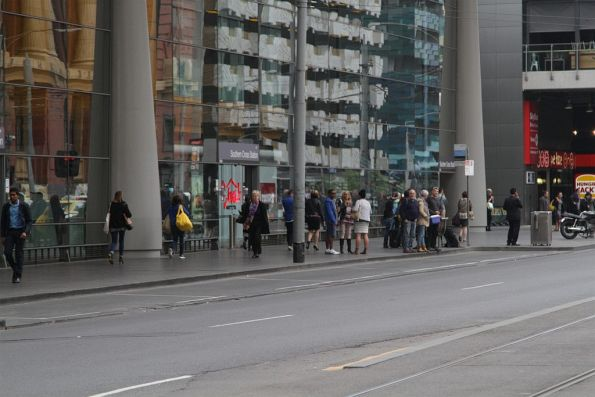 Waiting passengers at the taxi rank outside Southern Cross Station, but no taxis to be found