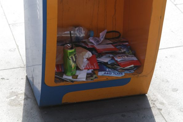 mX newspaper stand now used as a rubbish bin