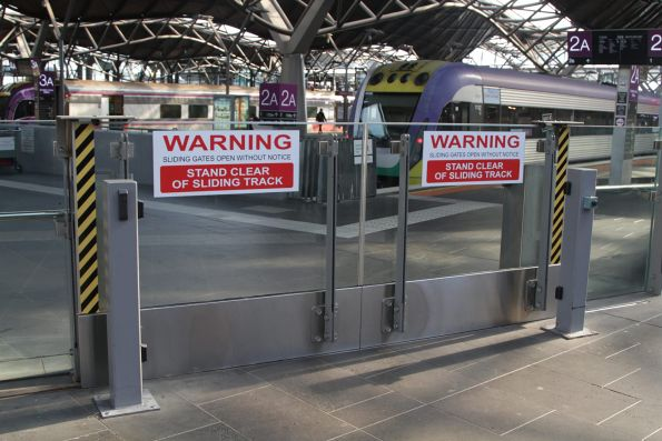'Warning - stand clear' notices on the locked gates giving access to the V/Line platforms