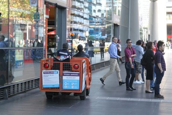 Travellers Aid buggy drives along the Spencer Street footpath