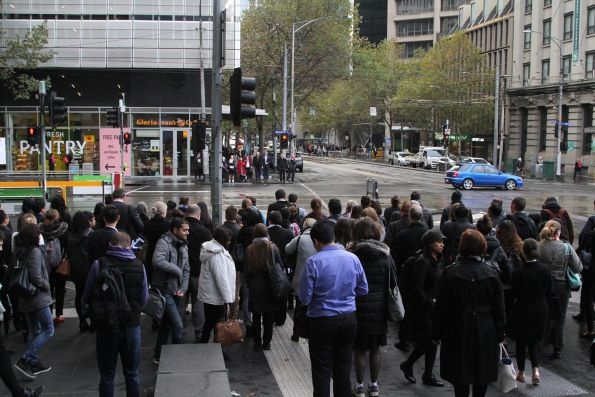 Crowd of commuters waiting to cross the corner of Spencer and Collins Street