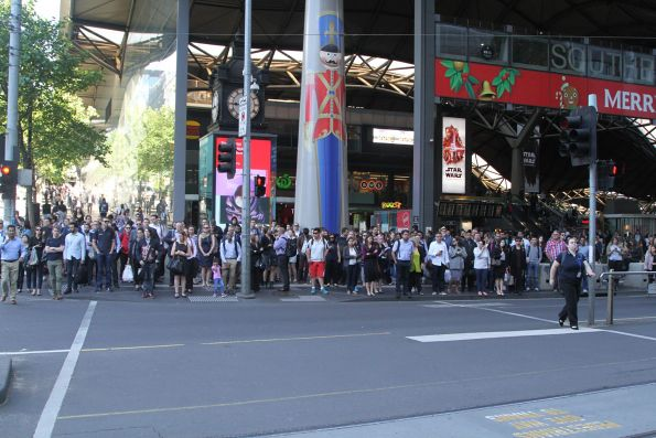 Crowd of commuters waiting for non-existent cars outside Southern Cross Station