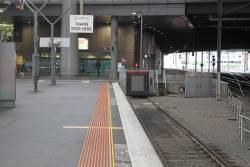 'Metro Trains stop here' sign at the south end of Southern Cross platform 8