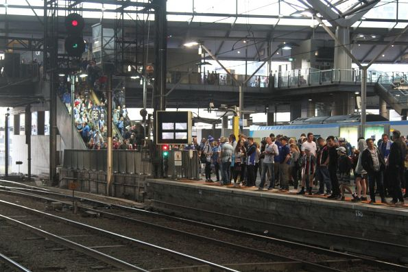 Football crowds start to fill Southern Cross platforms 9 and 10
