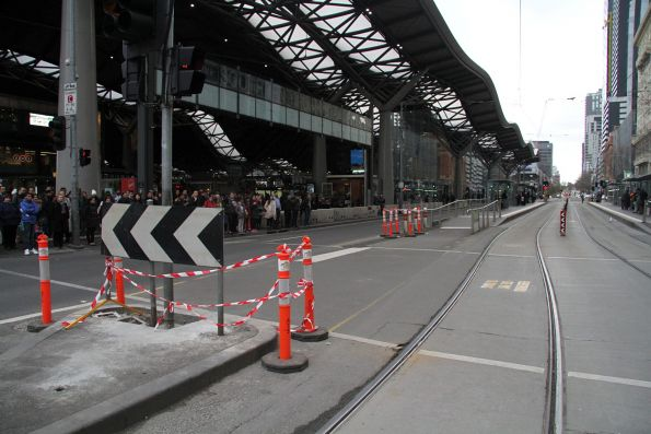Work underway to widen the pedestrian crossing at Spencer and Collins Street