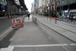 Tram stop fences removed and traffic lights relocated to enable the widening of the pedestrian crossing at Spencer and Collins Street