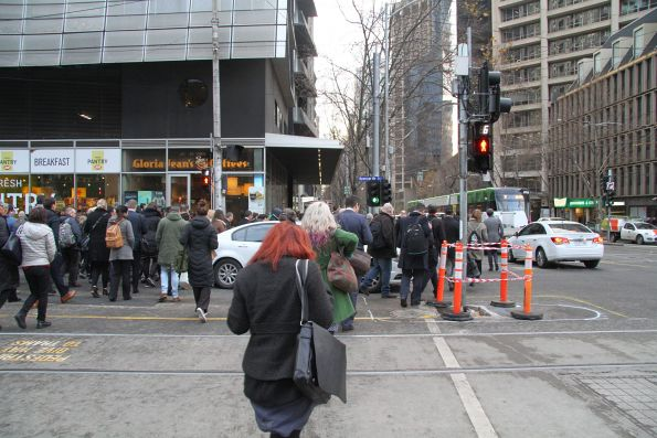 Clueless motorist stopped in the middle of the widened pedestrian crossing at Spencer and Collins Street