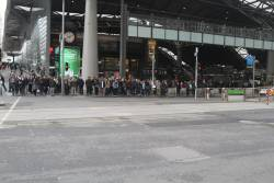 Crowd of waiting pedestrians at the widened crossing outside Southern Cross Station