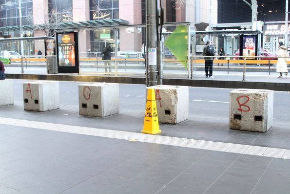 'A.C.A.B.' spraypainted on the concrete bollards outside Southern Cross Station